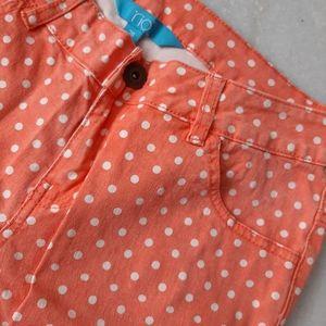 RIO orange with white polka dots jeans.